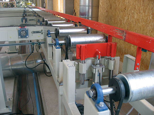 Conveyors for construction-timber